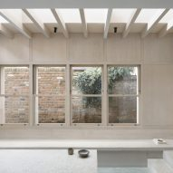 Windows line the walls of the extension
