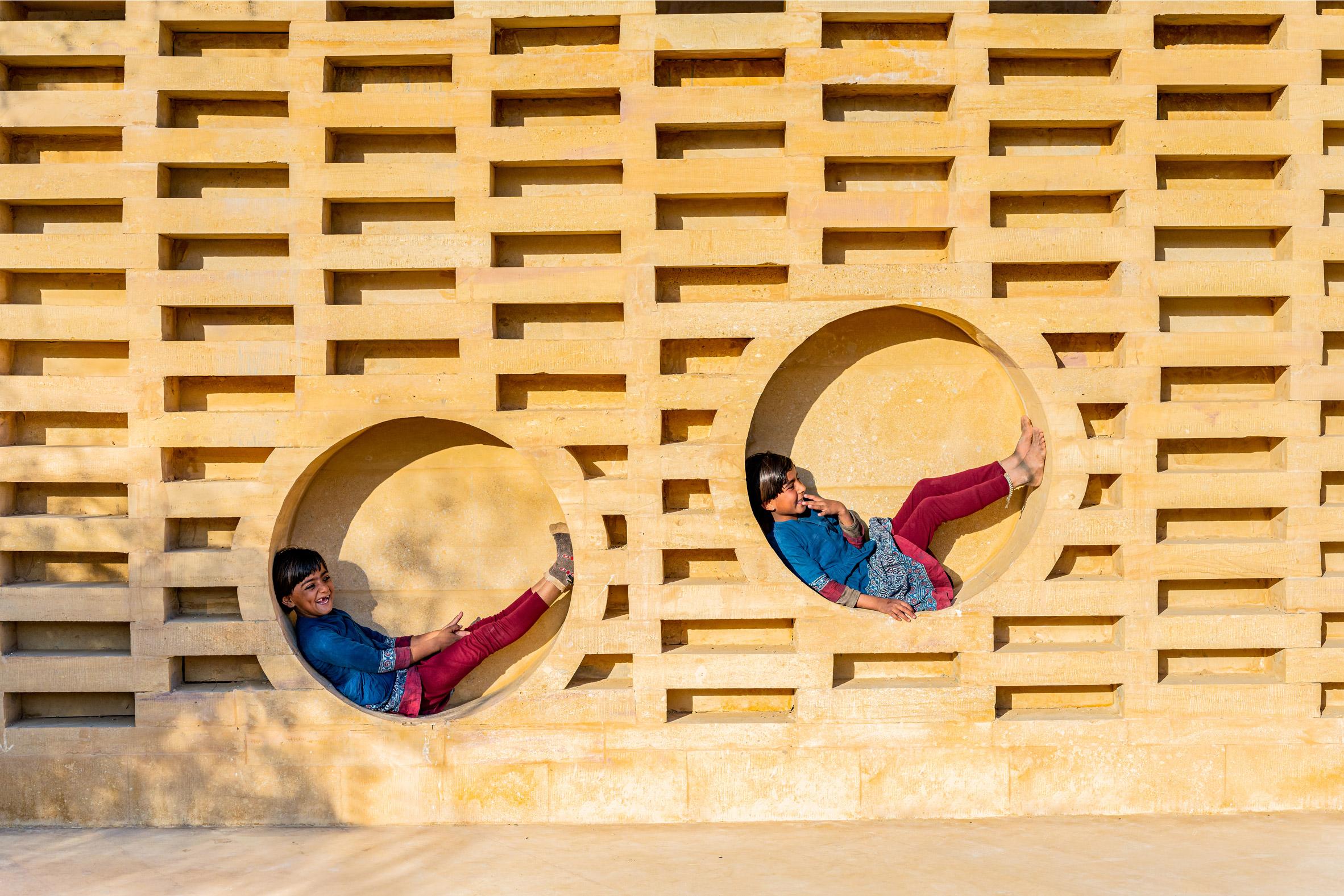 Children play within the brickwork