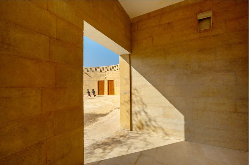 Sandstone was used across the walls and floors by Diana Kellogg Architects