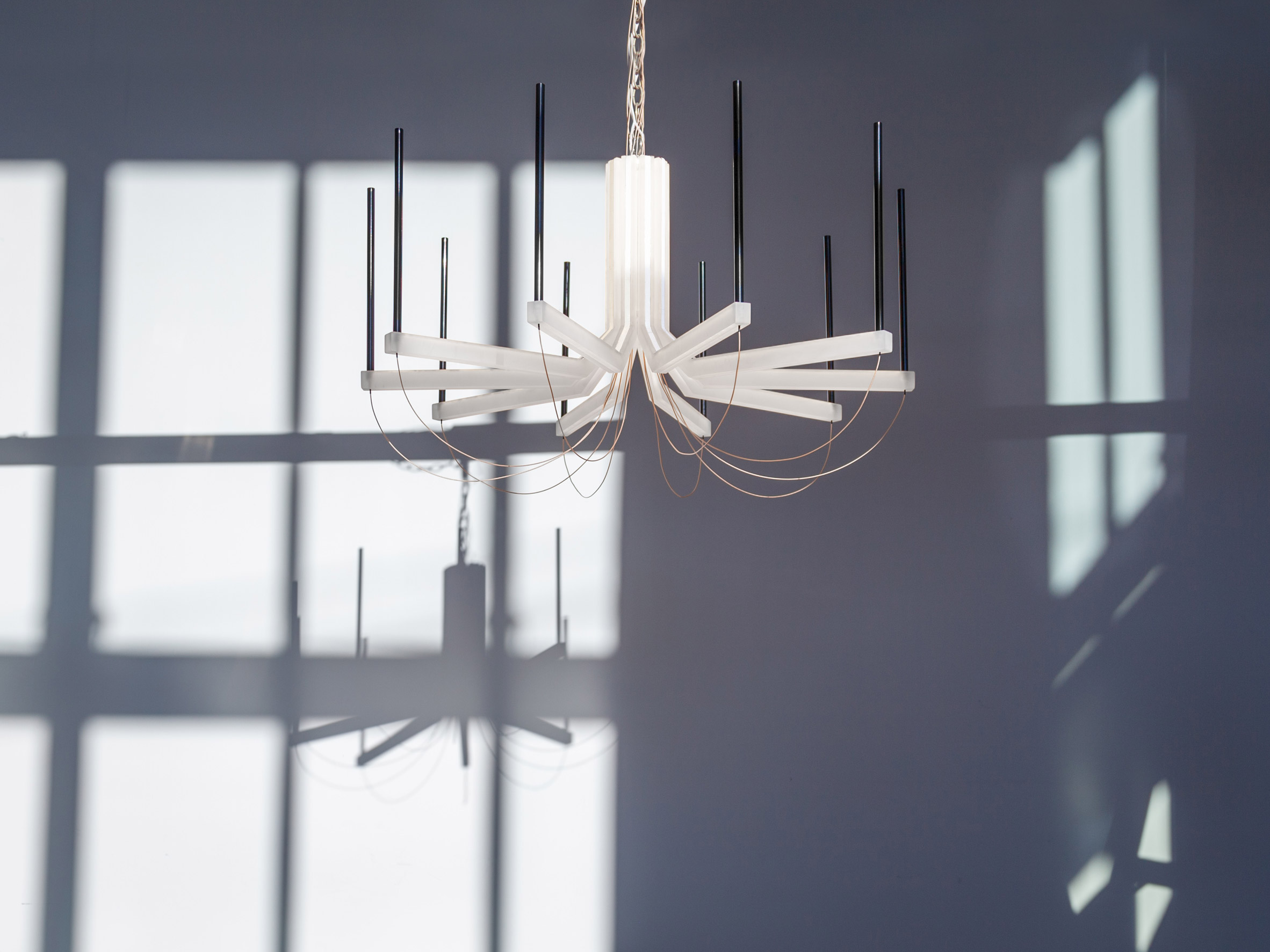 The chandelier takes cues from traditional chandeliers