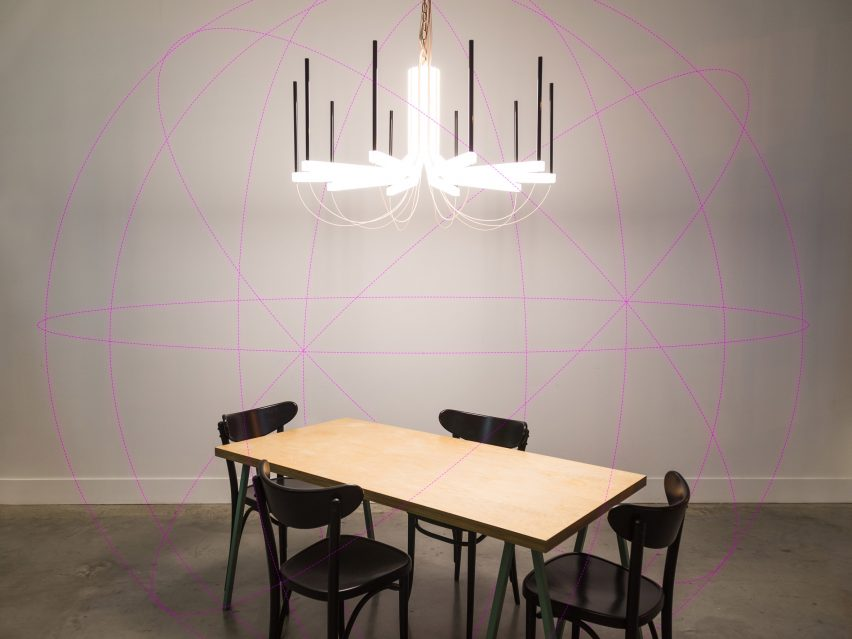 The chandelier is designed as a tech-free zone