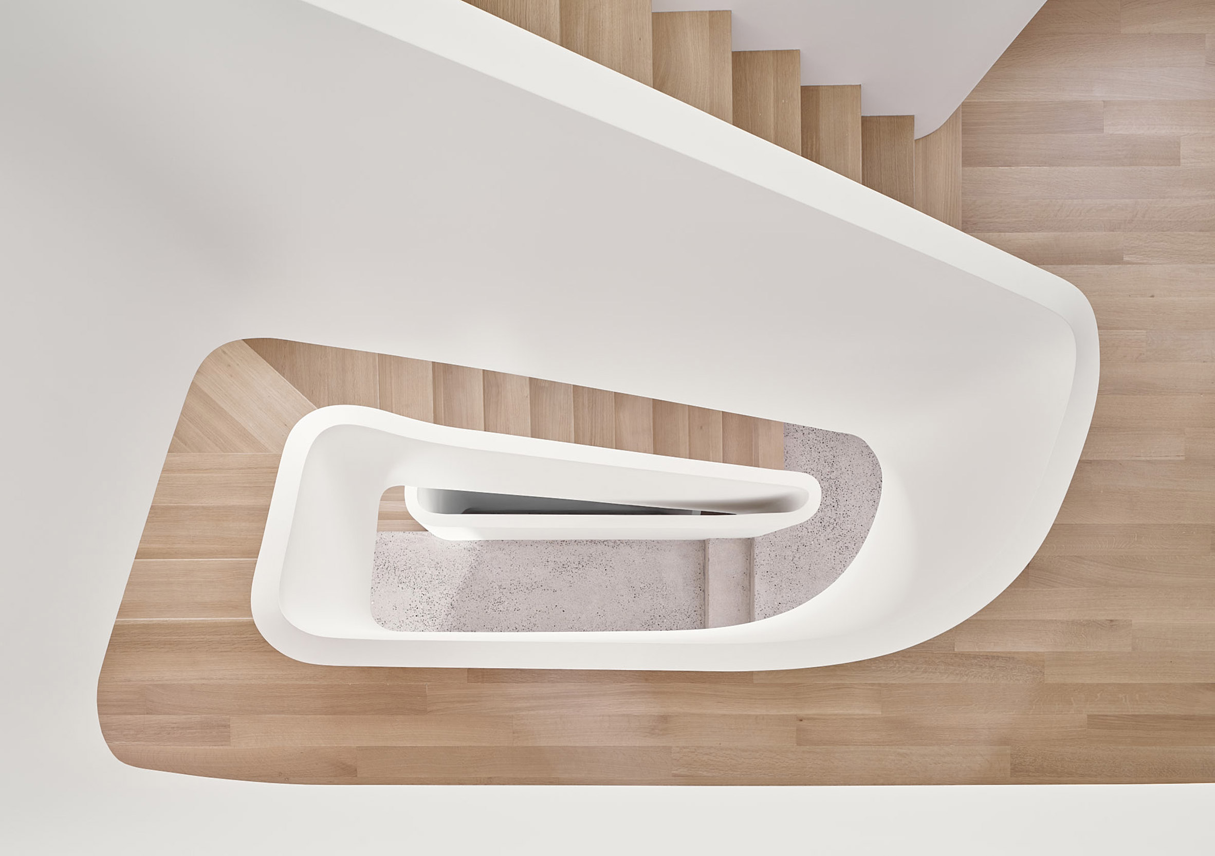 The sculptural staircase designed by Drew Mandel Architects