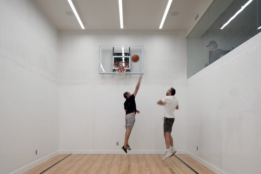 Drew Mandel Architects designed a basketball court in the basement