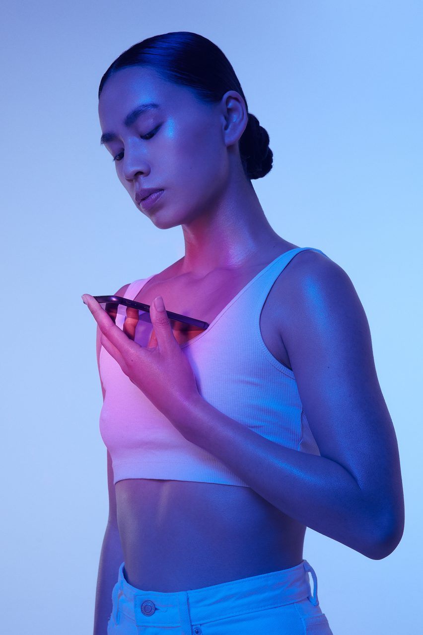 Woman holds glowing phone to her chest