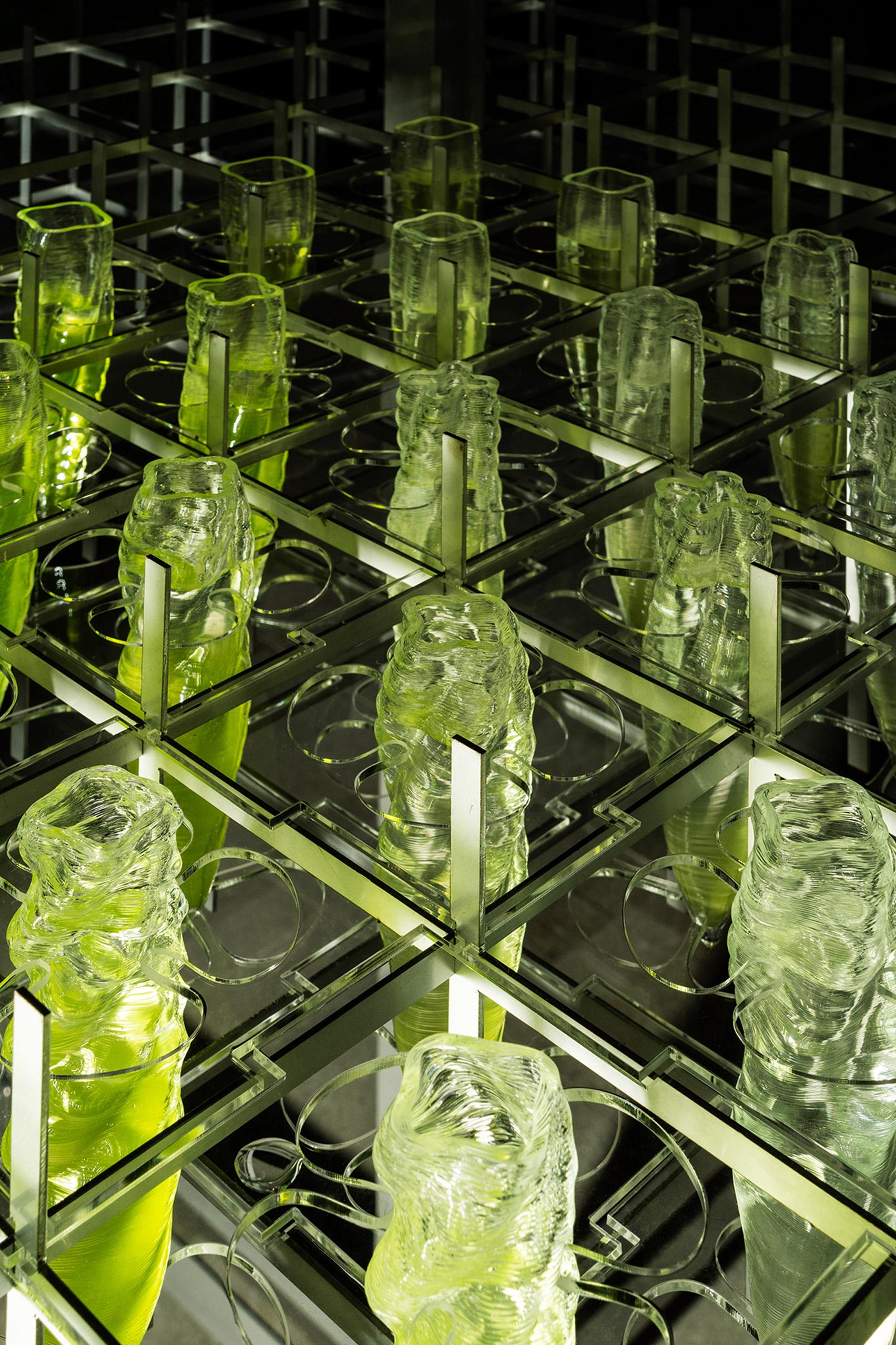 3D printed Swarovski crystal vessels full of green biogel