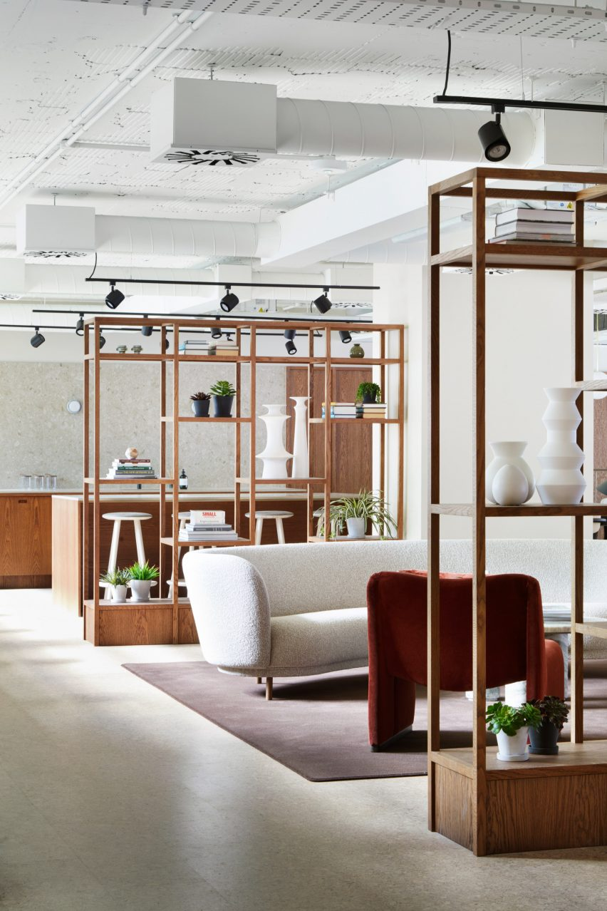 Open shelving and white couch in Fitzroy Street office interior