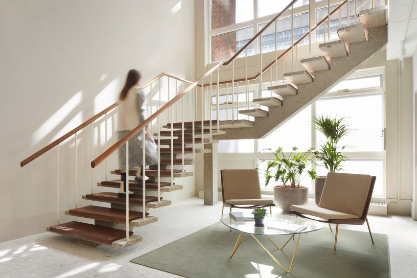 Seating area and concrete staircase in Fitzroy Street office interior