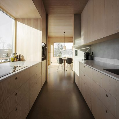 Light wood covers the kitchen