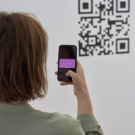 Woman scanning QR code