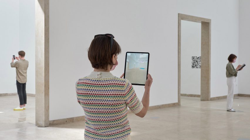 Visitor trying out QR code in German pavilion
