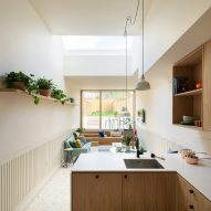A white-walled kitchen with wooden cabinets