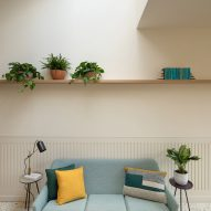 A living room with a blue sofa and terrazzo floor
