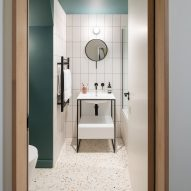 A green and white-tiled bathroom
