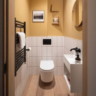 A white and yellow bathroom