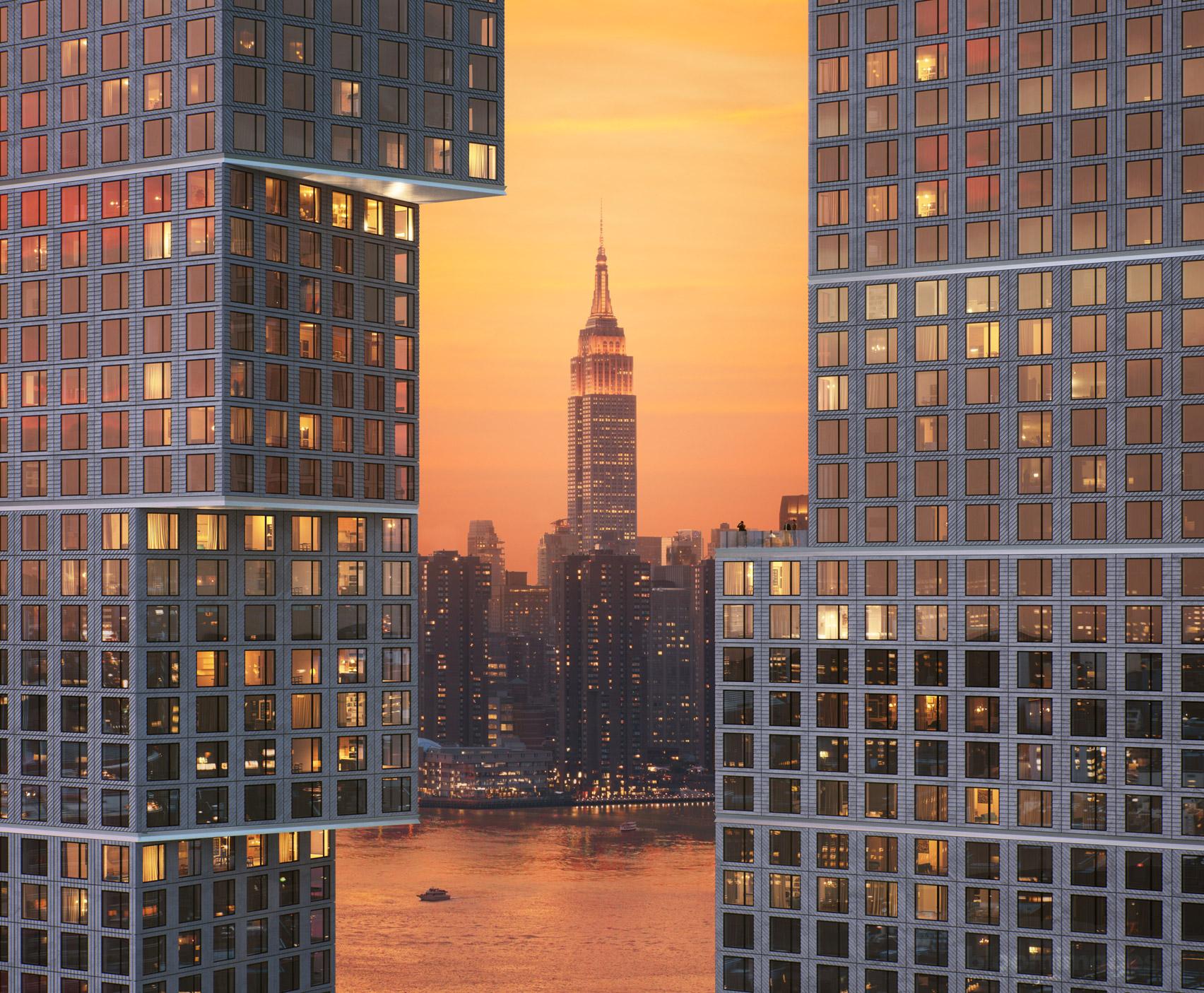 Manhattan skyline visible through towers at Greenpoint Landing