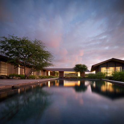 Sunset behind Hale Mau-u house and pool