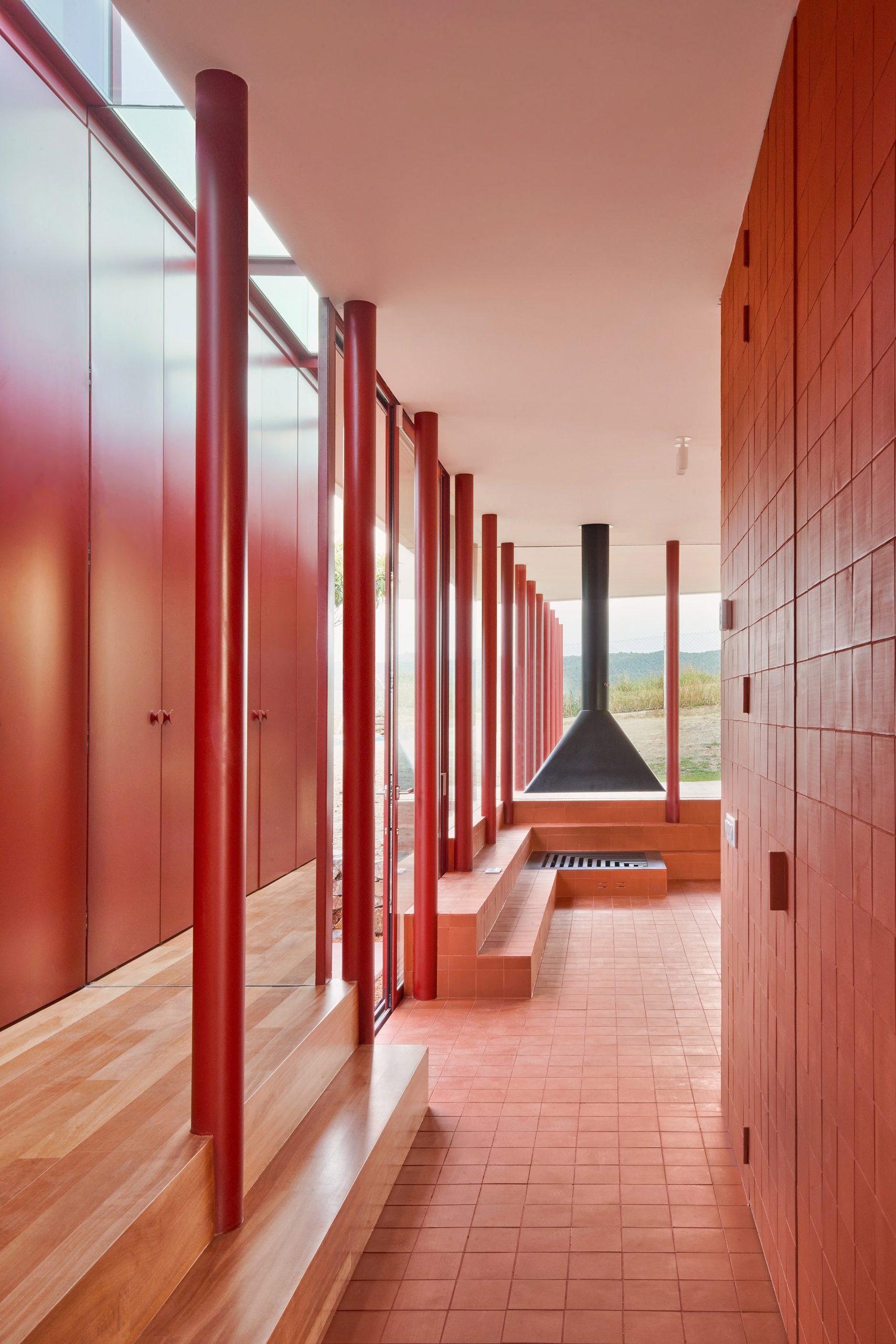 Living room in red House in Sant Antoni de Vilamajor by Arquitectura-G