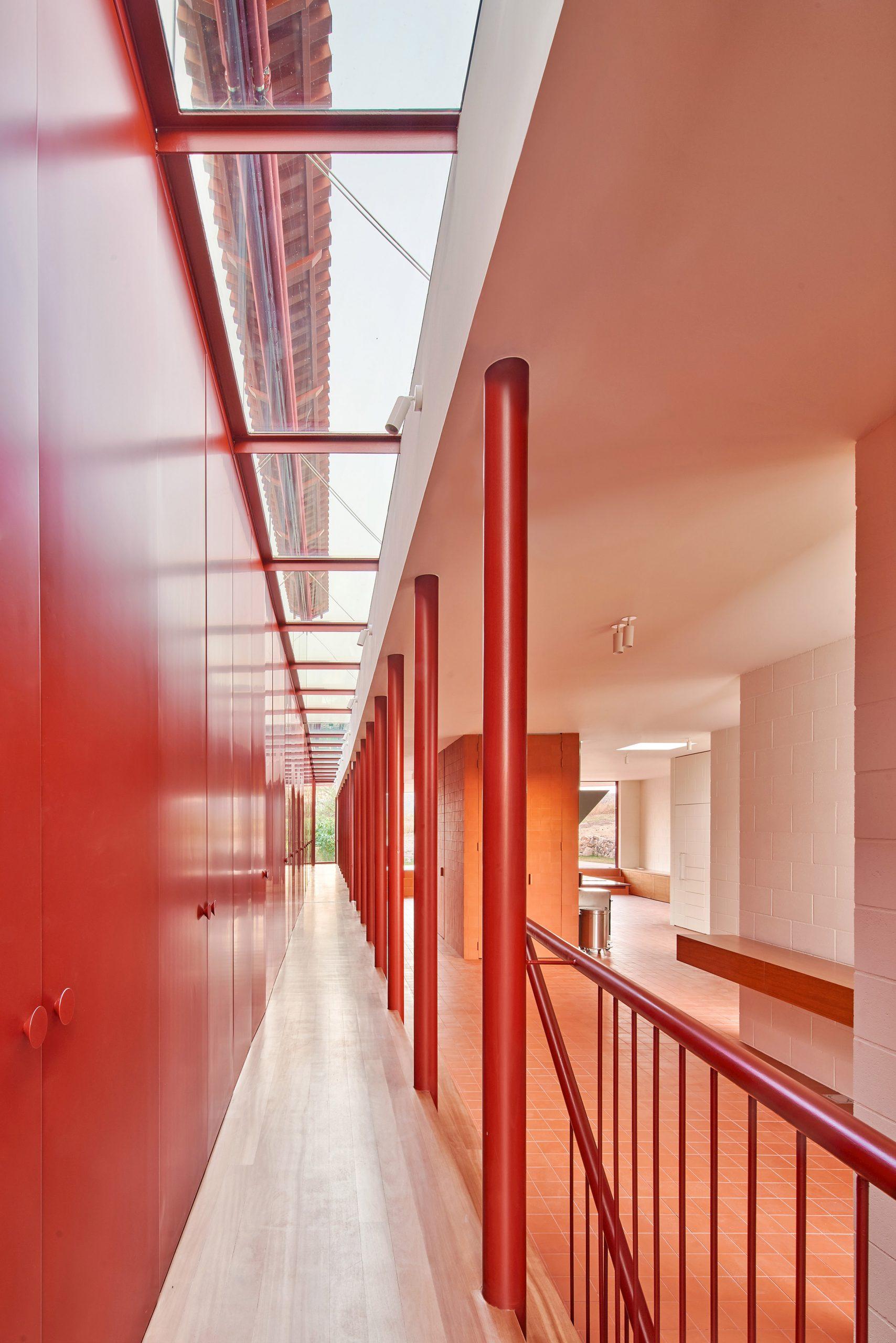 Corridor in red House in Sant Antoni de Vilamajor by Arquitectura-G