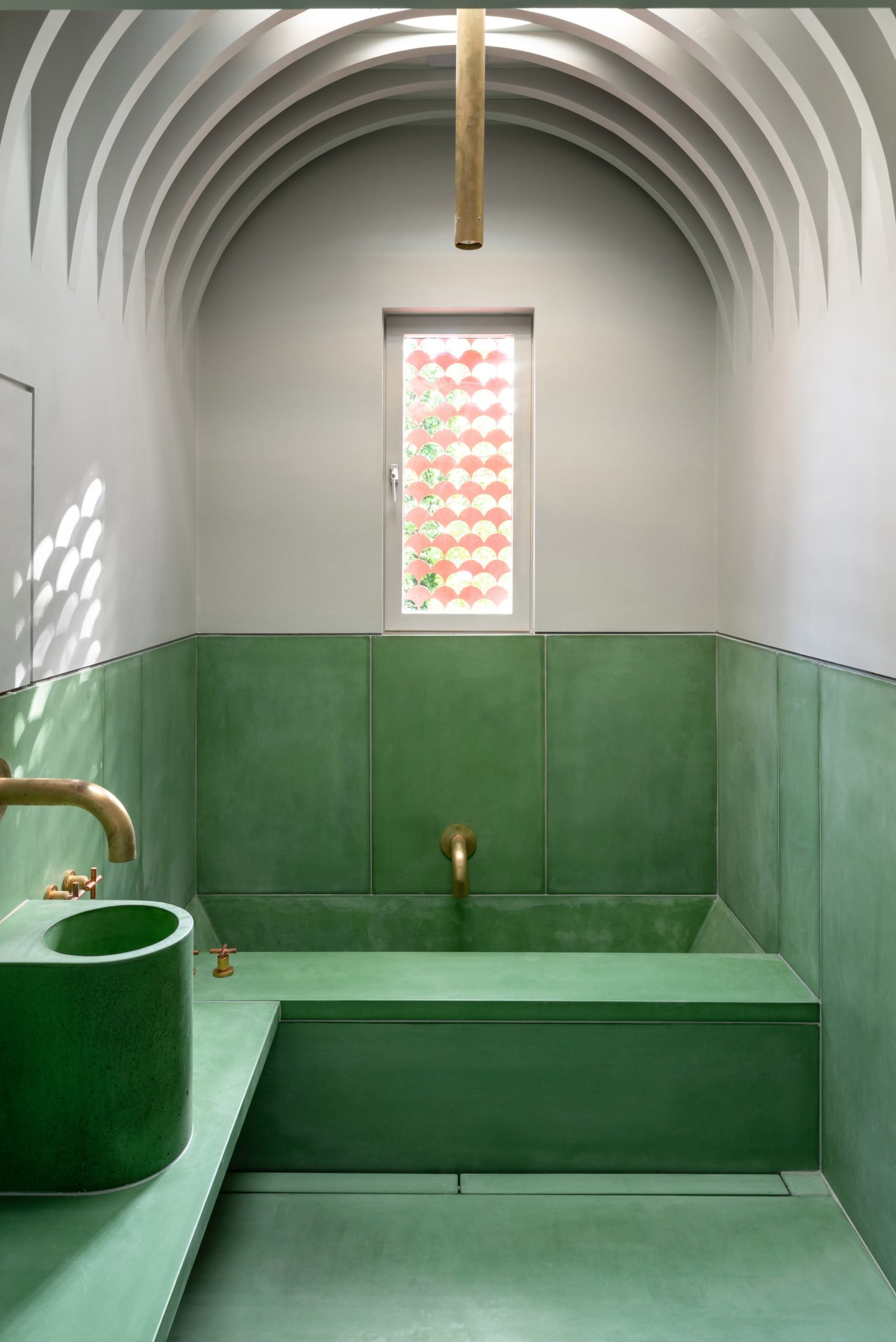 The bathroom in House Recast has a vaulted ceiling
