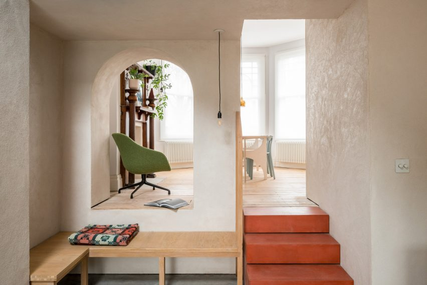Arches frame the living space in House Recast