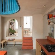 A living space is connected to the kitchen