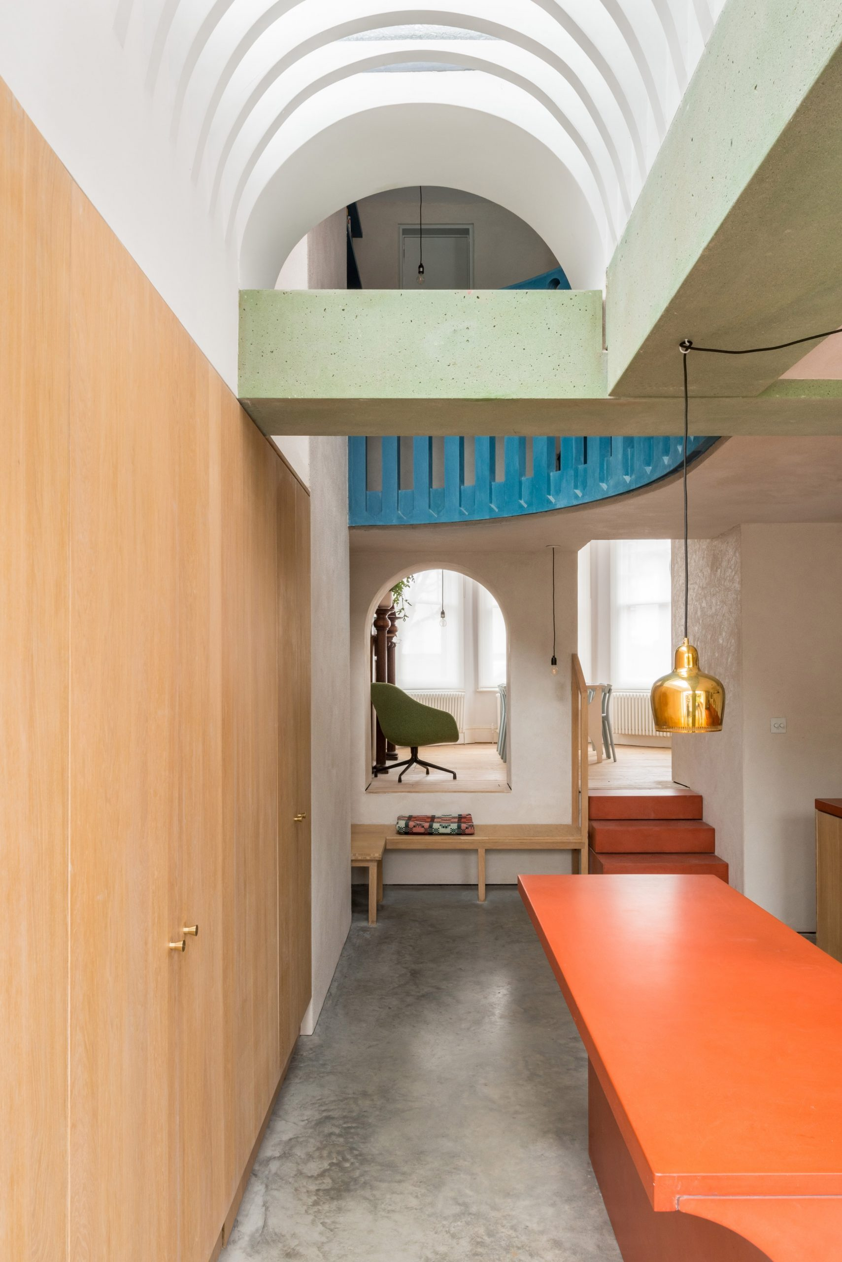 A green beam crosses the ceiling of Recast House