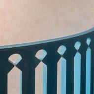 A blue balustrade has a geometric design