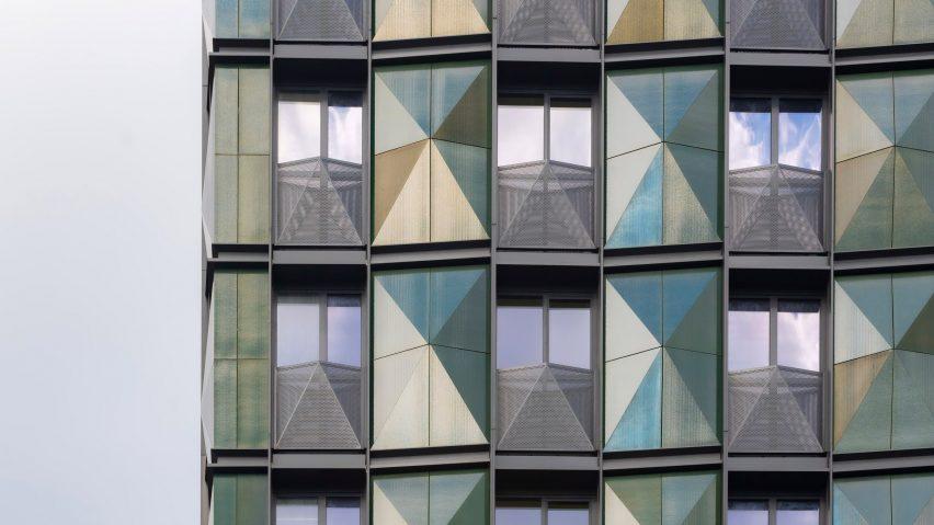 Terracotta panels cover the facade