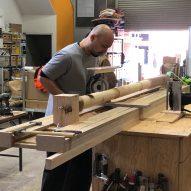 Craftsperson working on a lathe