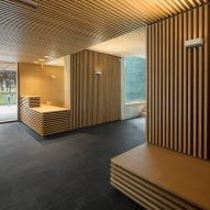 Seating and desks are clad in wood batons