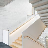Staircases have a light wood finish