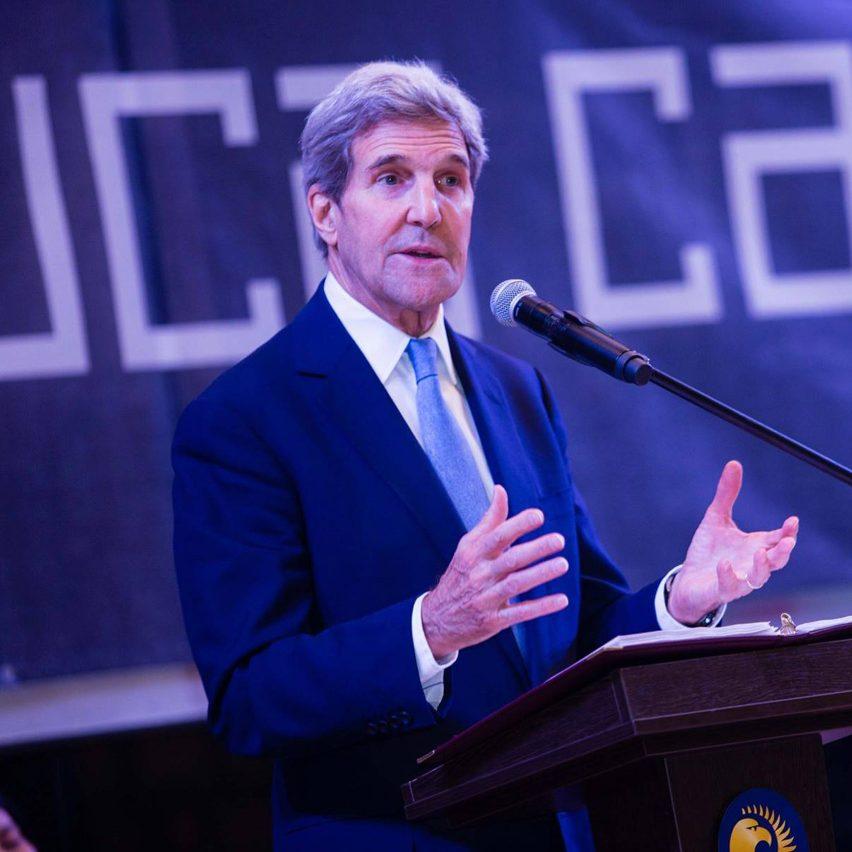 John Kerry speaking at a podium