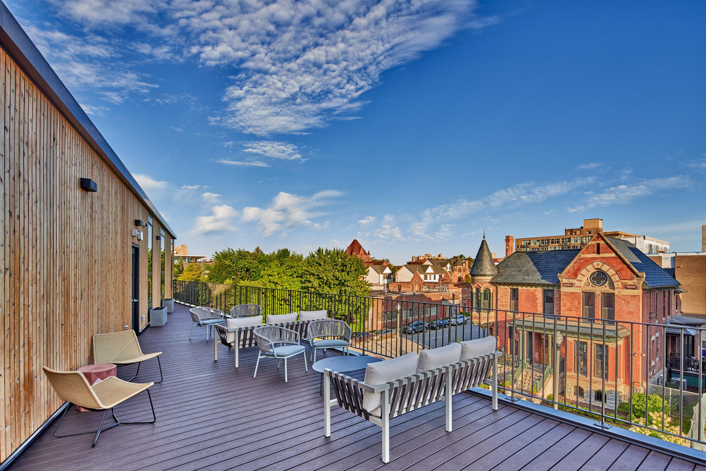 A communal terrace overlooks a vast Victorian mansion