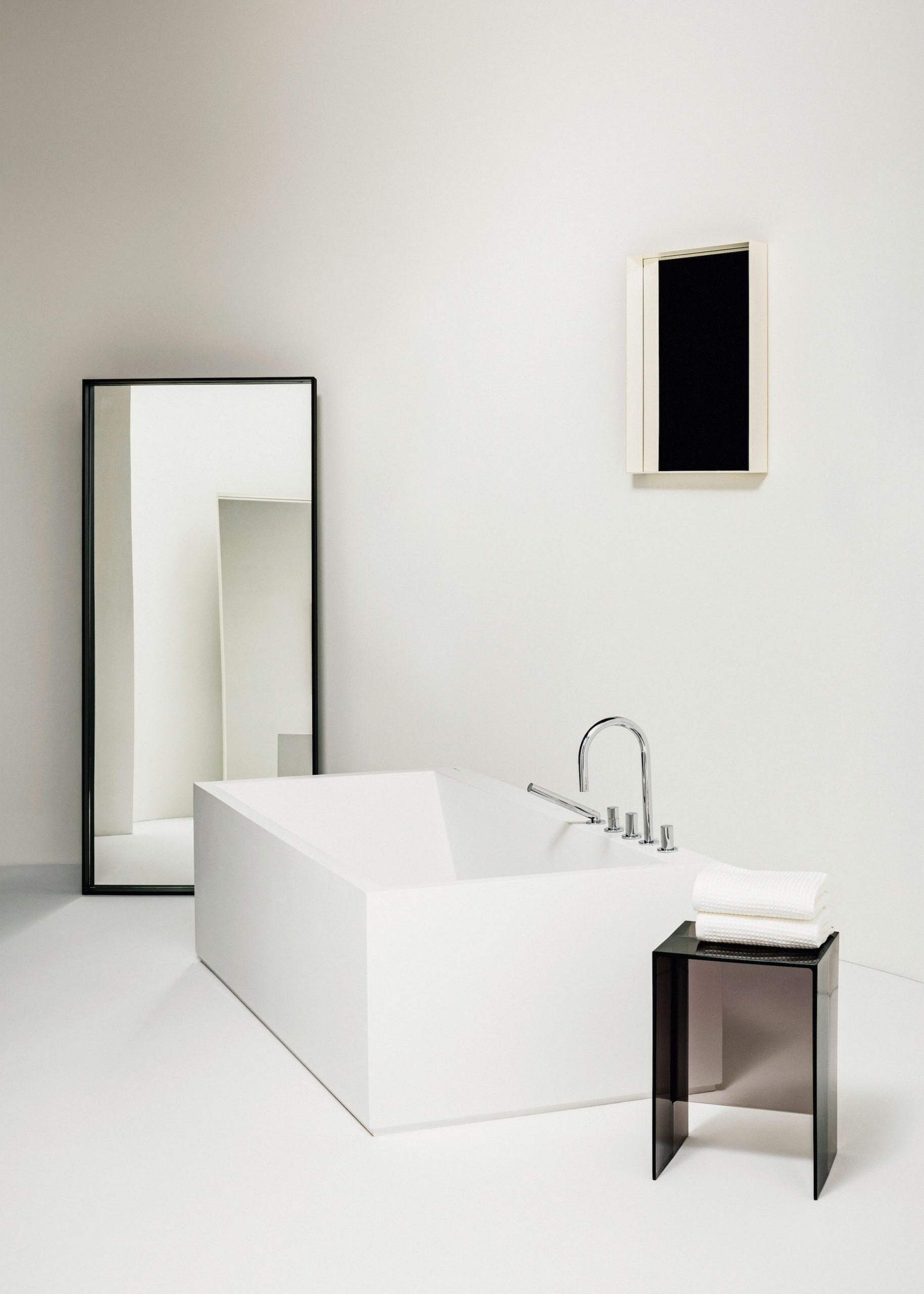 A white bathroom with a freestanding bathtub