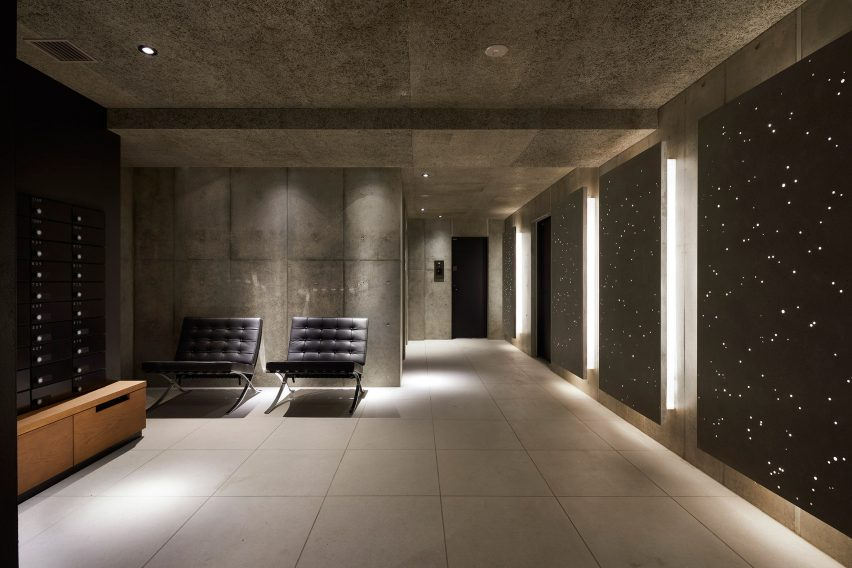 Concrete covers the walls of the interior of Kannai Blade Residence