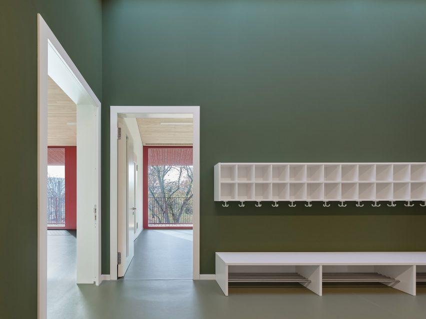 Interior walls at KiTa Parkstrasse by Birk Heilmeyer und Frenzel Architektenhave a green finish