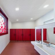 The bathroom has a red and white finish