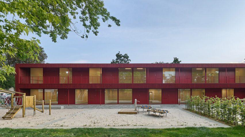 The kindergarten has a red exterior