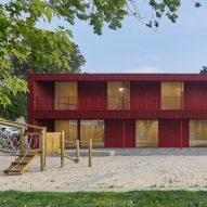 Birk Heilmeyer und Frenzel uses air-raid shelter as foundation for red daycare centre