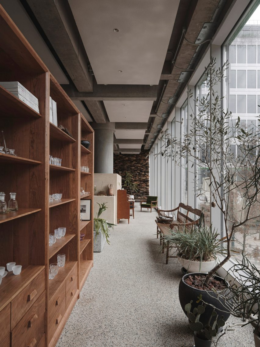 Wooden shelving and benches in Lost & Found Hangzhou store