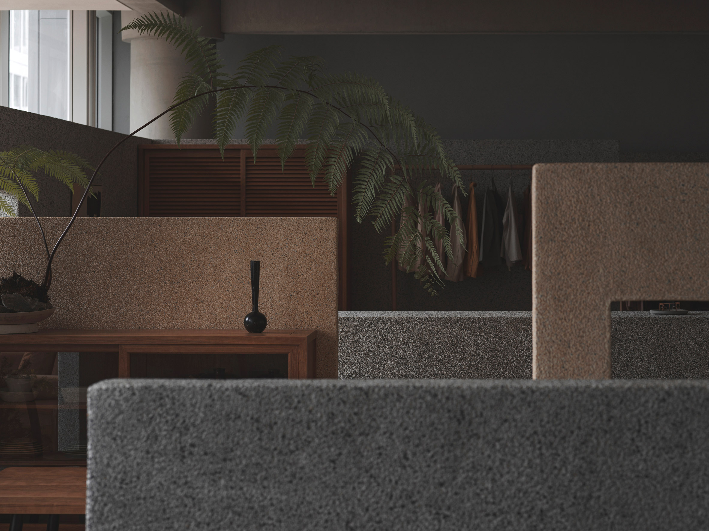 Washed stone partition walls in grey and beige in store interior by BLUE Architecture Studio