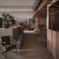 BLUE Architecture Studio inserts rustic cabin into Hangzhou furniture store