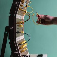 Hand connected a cable on a custom modular synthesiser