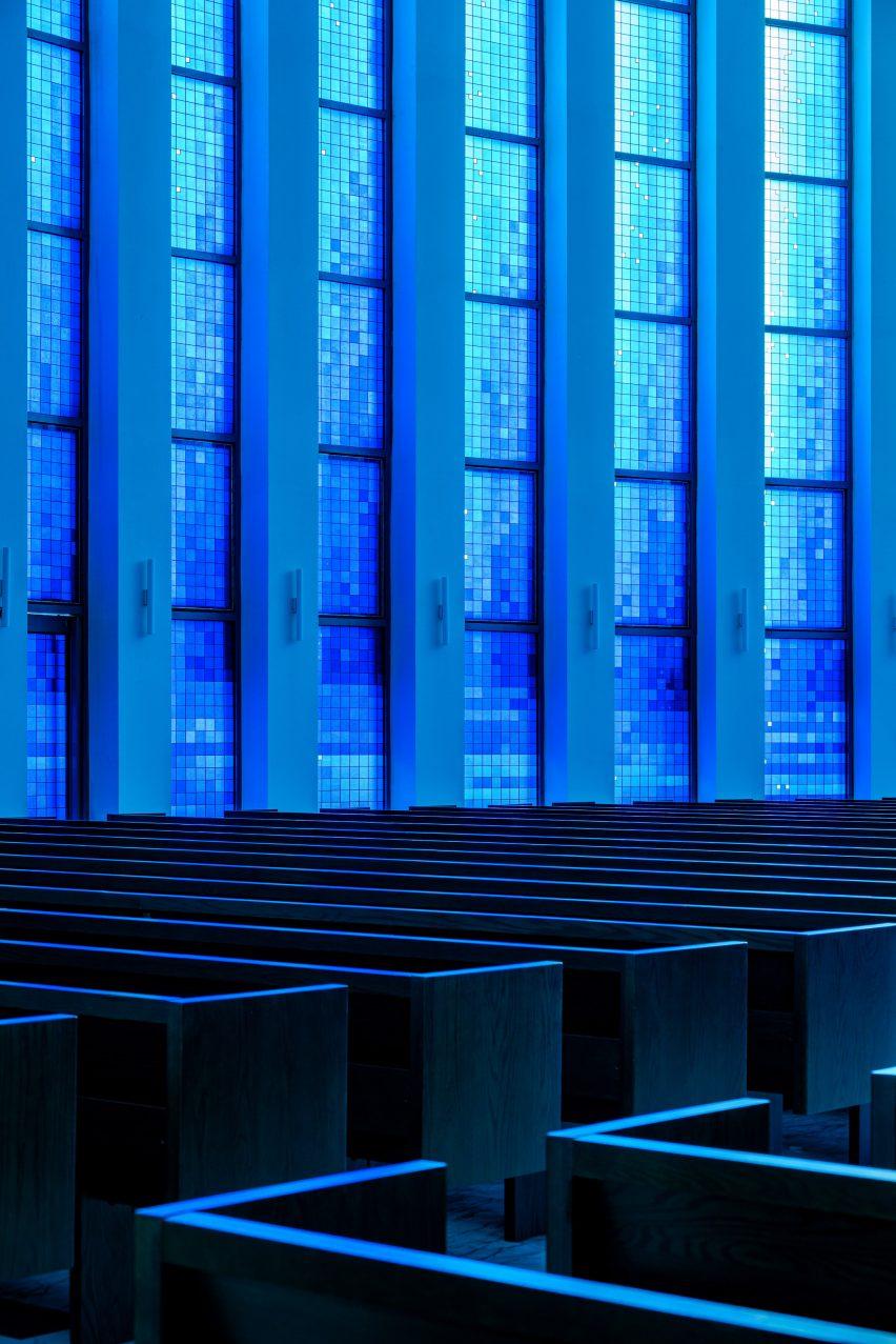 The church's main hall is illuminated by blue light