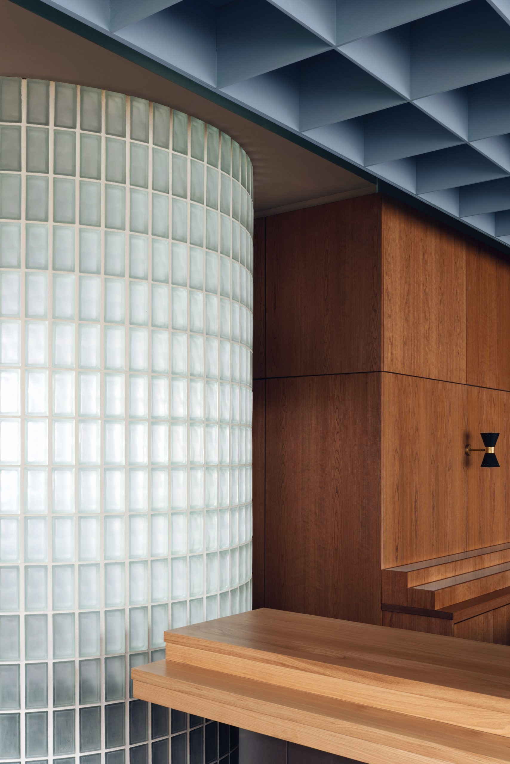 Glass blcok wall and wooden cupboard in Maido restaurant