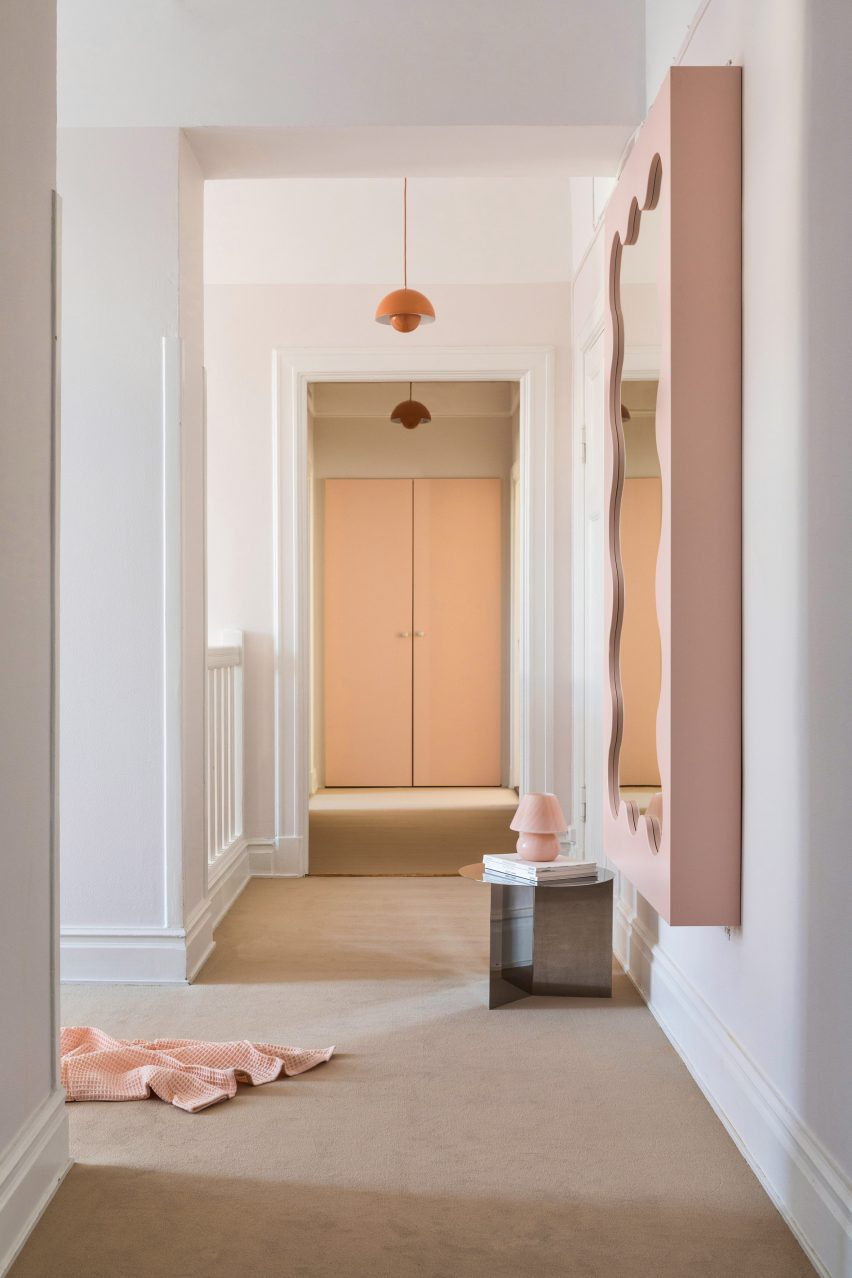 Pink mirror in the hallway