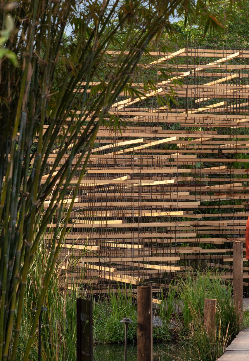 Wood was stacked and arranged in a lattice formation at the Straw Pavilion by MIA Design Studio