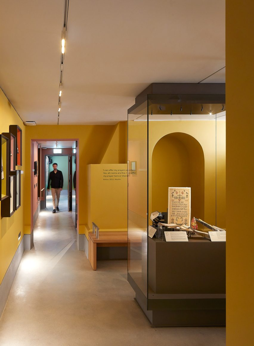 A yellow-walled exhibition space