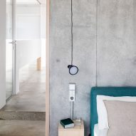 Bedrooms have exposed concrete walls