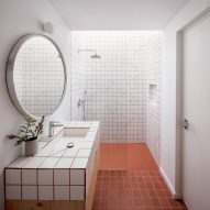Square tiles cover the walls and floors